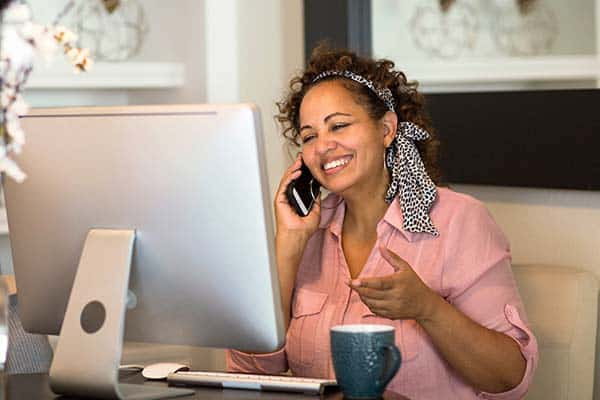 woman working online at home